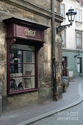 Red Roses - Atmospheric cafe in backstreet Krakow Poland by Dariusz Gora