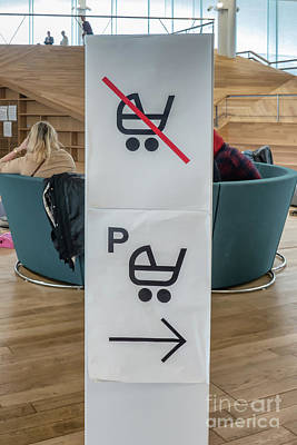 Keith Richards - Baby carriage parking sign in a public library by Frank Bach