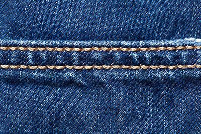 School Teaching - Blue denim texture with stitch line closeup, Jeans background by Julien