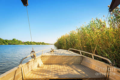 Royalty-Free and Rights-Managed Images - Boat On Namibia Side Of Chobe River by THP Creative