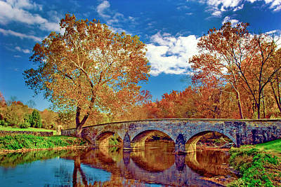 Lucille Ball Royalty Free Images - Burnside Bridge at Antietam in Fall Colors Royalty-Free Image by Paul W Faust - Impressions of Light