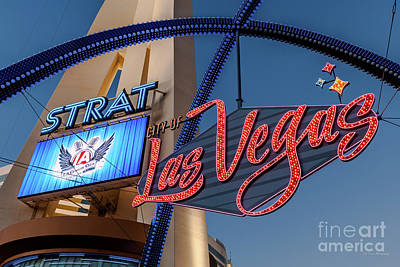 Photograph - City of Las Vegas Arch and the Strat Close at Dusk by Aloha Art