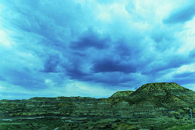 Peacock Feathers - Cloud formation over the badlands in Glendive Montana by Jeff Swan