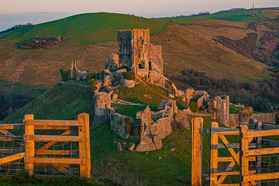 Clouds - Corfe castle in England framed at sunset. by George Afostovremea
