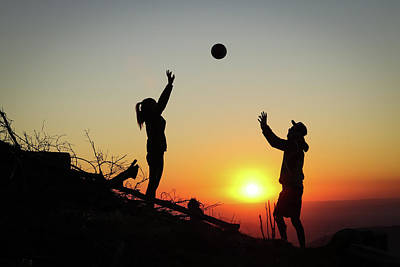 Sports Royalty-Free and Rights-Managed Images - Couple is playing volleyball at sunset by Vaclav Sonnek