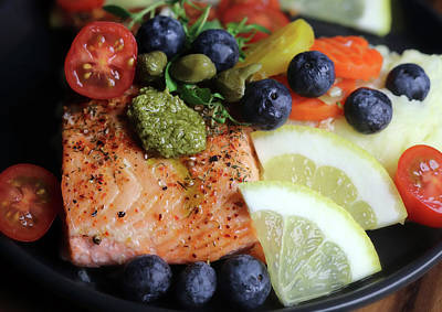 Animals Royalty-Free and Rights-Managed Images - Delicious And Healthy Salmon With Blueberries Tomatoes And Capers by Johanna Hurmerinta