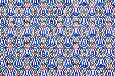 Royalty-Free and Rights-Managed Images - Detail of a moroccan painted multi-coloured traditional mosaic-tiled wall in blue, green, yellow, brown. Morocco by Julien