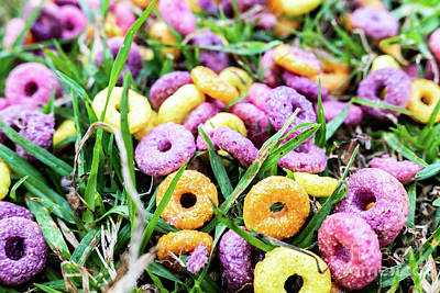Typography Tees - Detail of a ring cereal breakfast of bright colors scattered on  by Joaquin Corbalan