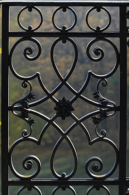 Photograph - Detail of an ornament in an iron fence by Stefan Rotter