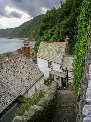 Beaches And Waves Rights Managed Images - Down-A-Long Cobbles And Cottages Clovelly Devon Royalty-Free Image by Richard Brookes