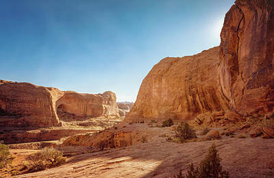 State Love Nancy Ingersoll Rights Managed Images - Hiking Back from Corona Arch Moab Utah Royalty-Free Image by Joan Carroll