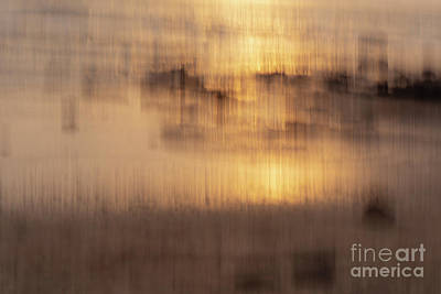 Travel Rights Managed Images - Impressionist image of sunset reflection in water Royalty-Free Image by Kiran Joshi