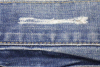 Curated Travel Chargers - Jeans texture background.  by Julien