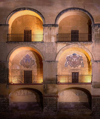 Farmhouse Rights Managed Images - Lighted Arched Balconies Cordoba Spain Royalty-Free Image by Joan Carroll