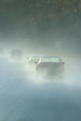 Bicycle Patents - Line Of Cars Drive Through Rain And Puddles On Freeway by Taya Johnston