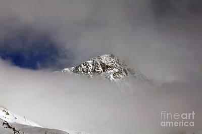 Modern Man Music - Mist and cloud swirling around Pointe de Thorens Val Thorens Three Valleys  Savoie France by Michael Walters