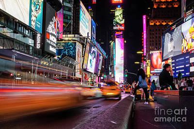 Photograph - Night time traffic in Times Square.  by Dawid Swierczek