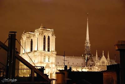 Photograph - Notre Dame at Night by Miguel Lecuona