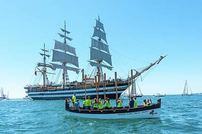 Photograph - Oarsman boat welcoming the Tall ship Amerigo Vespucci in the Taanto Harbour by Flavio Massari