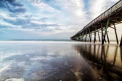 Design Pics - Oceanna Pier With Blue Skies and Dark Clouds Reflected by Bob Decker