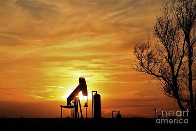 Curated Beach Towels - Oilwell Pump silhouette in Kansas with a colorful Sunset by Robert D Brozek