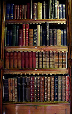 Photograph - Old Leather bound books in a bookcase by Tom Conway