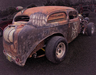 Photograph - Old Rusted Sedan by Phyllis Stokes