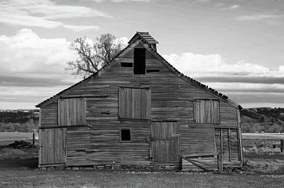 Peacock Feathers - Old wooden barn in black and white by Jeff Swan