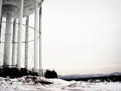 Surrealism Royalty-Free and Rights-Managed Images - Ominous looking White Water Tower on Snow Covered Hill in New England by Stephen Orsillo