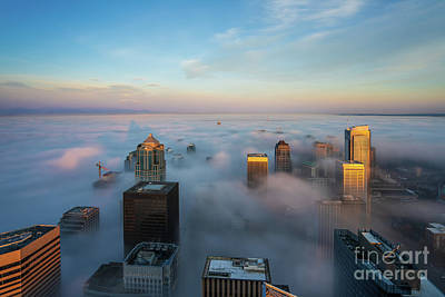 Vermeer Rights Managed Images - Over Seattle Sunrise City in the Clouds Royalty-Free Image by Mike Reid