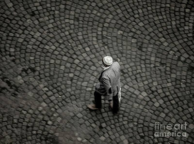 1-war Is Hell - Overhead view of Muslim man with kufi walking on street by John Wollwerth