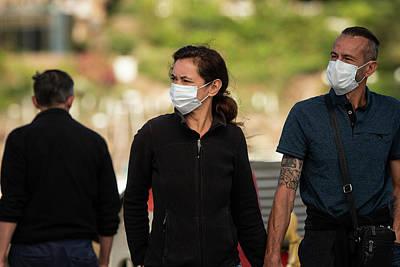 Priska Wettstein Pink Hues - People wearing a mask on the street outdoors by Stefan Rotter