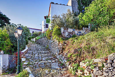 Farmhouse Rights Managed Images - Picturesque alley in the old Chora of Alonissos, Greece Royalty-Free Image by Constantinos Iliopoulos