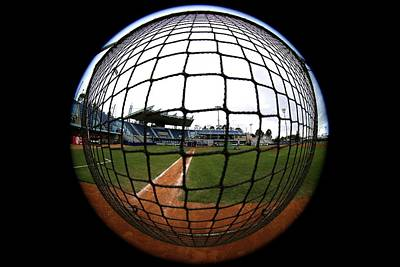 Royalty-Free and Rights-Managed Images - Rectangular protective baseball screen in use during batting practice. by Joe Vella