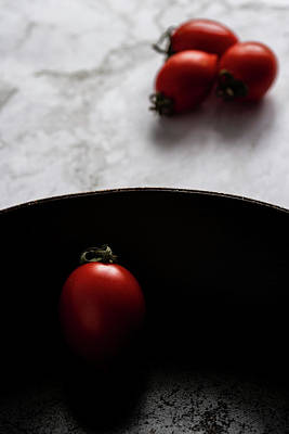 Photograph - Red fresh healthy tomatoes isolated on a black pan by Michalakis Ppalis