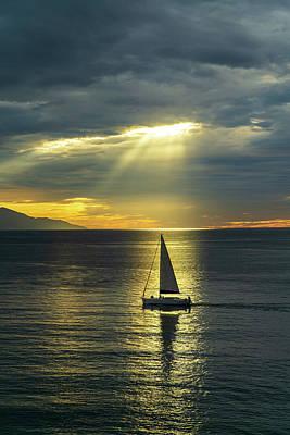 Photograph - Sailboat in a Sunbeam by Dave Matchett