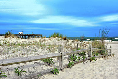 Clouds Rights Managed Images - Sand Dunes and Pier NJ Shore Royalty-Free Image by Regina Geoghan