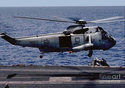 Keith Richards - SH-3 Sea King Hovers Over the Flight Deck of the USS Ranger by Wernher Krutein