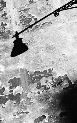 Surrealism Royalty-Free and Rights-Managed Images - Shadow of a Lamp on Crumbling Plaster Wall by Mark Robert Davey