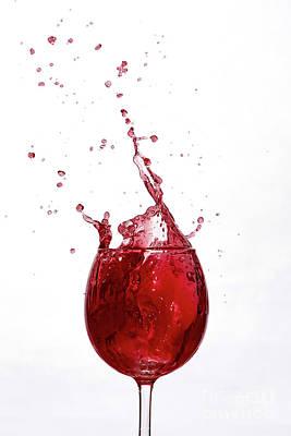 Photograph - Shot of a wine splashing in the air. Frozen motion. by Dawid Swierczek