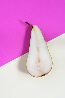 Photograph - Slice of healthy pear fruit on a colourful background. by Michalakis Ppalis