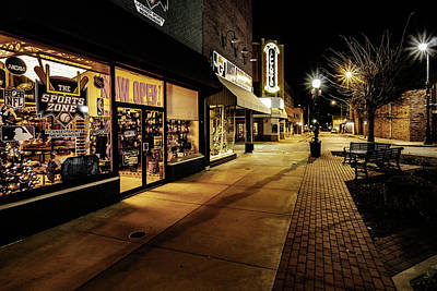 Travel Rights Managed Images - Small town storefronts at night Royalty-Free Image by Sven Brogren
