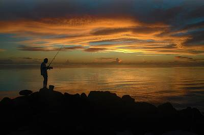 Uncle Sam Posters Rights Managed Images - Solitary Sunset Fishing Royalty-Free Image by Heidi Fickinger