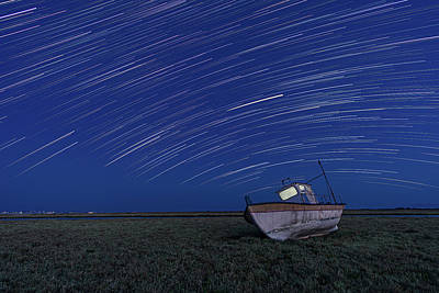 Abstract Stripe Patterns - Star Trails over an old boat by Alexios Ntounas