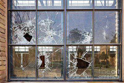 Kim Fearheiley Photography - Stoned window with broken glass of an industry. by Joaquin Corbalan
