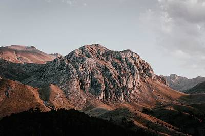 Royalty-Free and Rights-Managed Images - Strong Curves - aerial photography of brown and gray mountain ranges - Melikler Yaylas? Kamp Alan?, Turkey by Julien