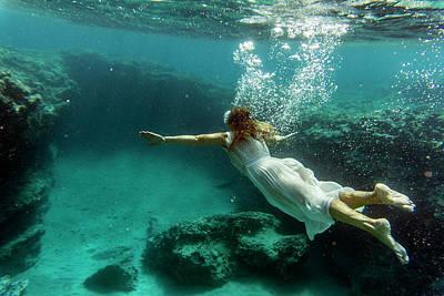 Photograph - Swimming underwater by Manolis Tsantakis