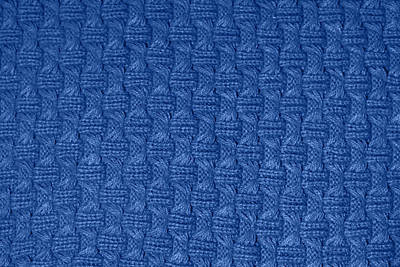 Royalty-Free and Rights-Managed Images - Texture knitting. Blue pullover. Pattern fabric made of wool. Background. Trending color in fashion design in the year 2020.  by Julien