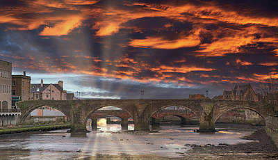 New Years Royalty Free Images - The Auld Brigg in Ayr in Scotland Dramatic Sunset over the town Royalty-Free Image by Jim McDowall