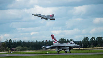 Photograph - The retired Swedish J35 Draken take off and the taxing Danish F16 Fighting Falcon by Torbjorn Swenelius